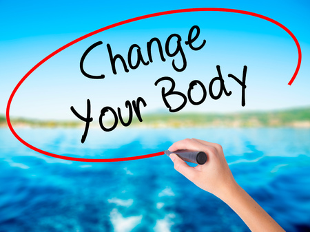 muscle gain: Woman Hand Writing Change Your Body on blank transparent board with a marker isolated over water background. Business concept. Stock Photo Stock Photo