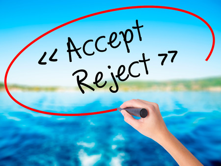 approvement: Woman Hand Writing Accept - Reject  on blank transparent board with a marker isolated over water background. Business concept. Stock Photo