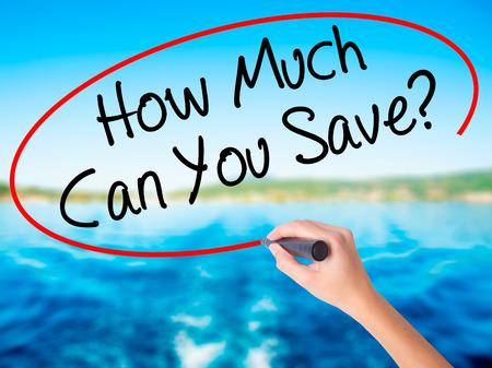mortgaging: Woman Hand Writing How Much Can You Save? on blank transparent board with a marker isolated over water background. Business concept. Stock Photo Stock Photo