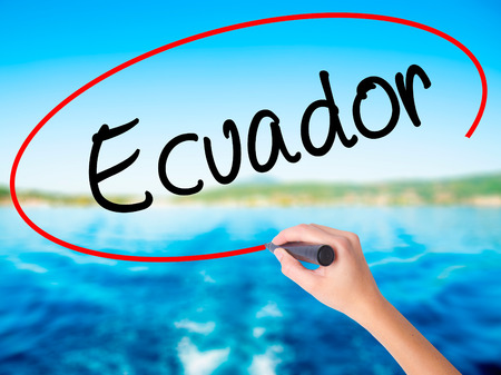 Woman Hand Writing  Ecuador  on blank transparent board with a marker isolated over water background. Business concept. Stock Photo Stock Photo