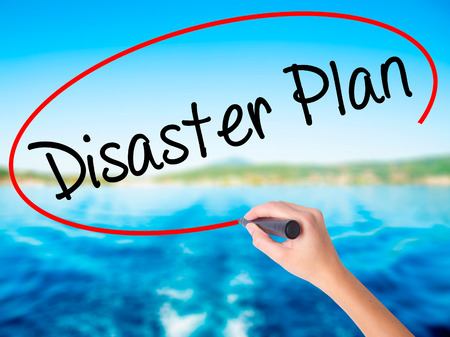 Woman Hand Writing Disaster Plan on blank transparent board with a marker isolated over water background. Business concept. Stock Photo Stock Photo