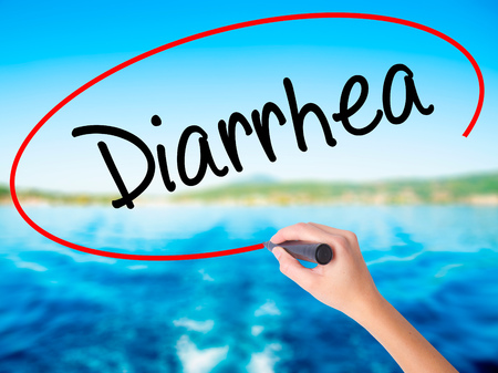 Woman Hand Writing  Diarrhea  on blank transparent board with a marker isolated over water background. Business concept. Stock Photo Stock Photo