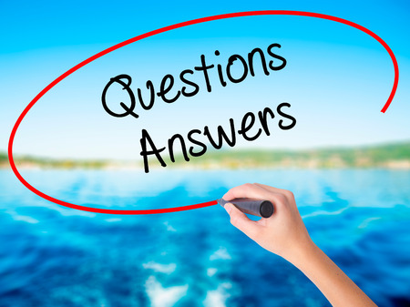 Woman Hand Writing Questions Answers on blank transparent board with a marker isolated over water background. Business concept. Stock Photo Stock Photo