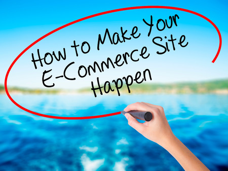b2b: Woman Hand Writing How to Make Your E-Commerce Site Happen on blank transparent board with a marker isolated over water background. Business concept. Stock Photo Foto de archivo