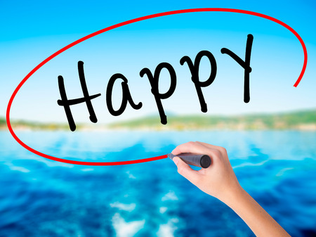 Woman Hand Writing Happy black marker on visual screen. Isolated on white. Business, technology, internet concept. Stock Image