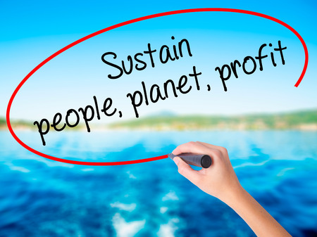 sustain: Woman Hand Writing Sustain, people, planet, profit on blank transparent board with a marker isolated over water background. Business concept. Stock Photo