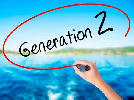 smarter: Woman Hand Writing Generation Z on blank transparent board with a marker isolated over water background. Business concept. Stock Photo