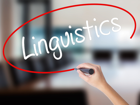 Woman Hand Writing Linguistics  with a marker over transparent board. Isolated on Office. Business,  technology, internet concept. Stock Photo