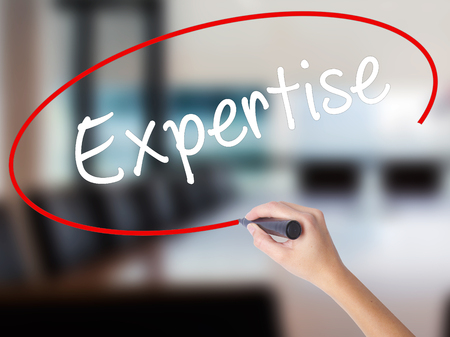 common goal: Woman Hand Writing Expertise with a marker over transparent board. Isolated on Office. Business concept. Stock Photo