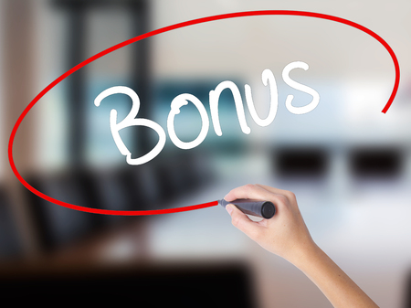 Woman Hand Writing Bonus with a marker over transparent board. Isolated on Office. Business concept. Stock Photo Stock Photo