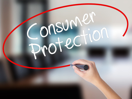 Woman Hand Writing Consumer Protection  with a marker over transparent board. Isolated on Office. Business concept. Stock Photo Stock Photo