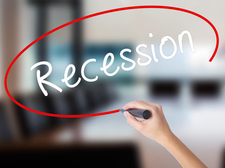 Woman Hand Writing Recession with a marker over transparent board. Isolated on Office. Business concept. Stock Image