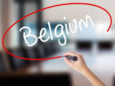Woman Hand Writing Belgium  with a marker over transparent board. Isolated on Office. Business concept. Stock Photo Stock Photo