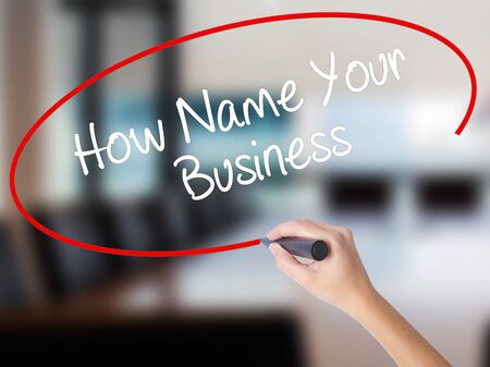 Woman Hand Writing How Name Your Business with a marker over transparent board. Isolated on Office. Business concept. Stock Photo Stock Photo