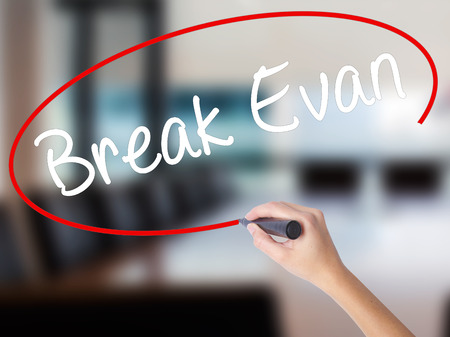 Woman Hand Writing Break Evan with a marker over transparent board. Isolated on Office. Business concept. Stock Photo