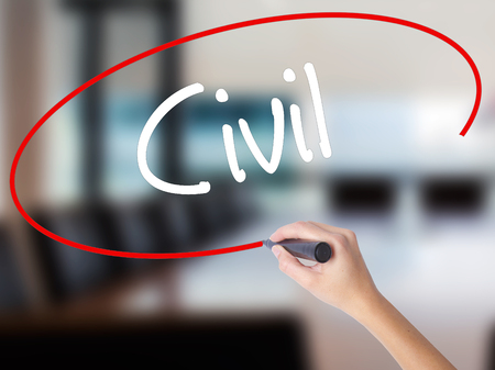 Woman Hand Writing Civil with a marker over transparent board. Isolated on Office. Business concept. Stock Photo