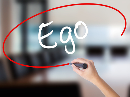 Woman Hand Writing Ego with a marker over transparent board. Isolated on Office. Business concept. Stock Photo Stock Photo
