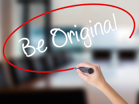 distinct: Woman Hand Writing Be Original with a marker over transparent board. Isolated on Office. Business concept. Stock Photo Stock Photo