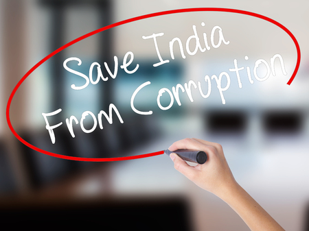 marchers: Woman Hand Writing Save India From Corruption with a marker over transparent board. Isolated on Office. Business concept. Stock Photo Stock Photo
