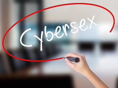 Woman Hand Writing Cybersex  with a marker over transparent board. Isolated on Office. Business concept. Stock Photo Stock Photo