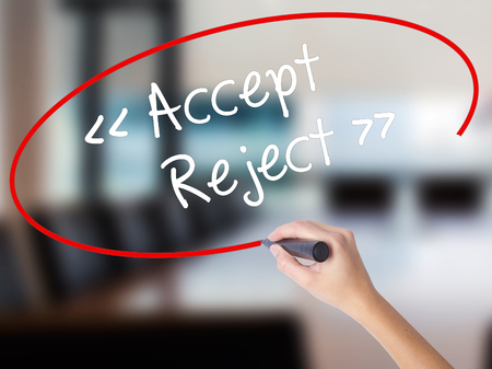 approvement: Woman Hand Writing Accept - Reject  with a marker over transparent board. Isolated on Office. Business concept. Stock Photo