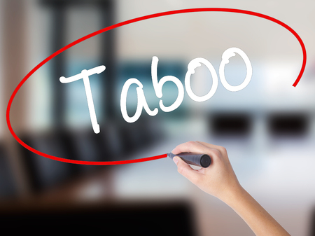 taboo: Woman Hand Writing Taboo with a marker over transparent board. Isolated on Office. Business concept. Stock Photo Stock Photo