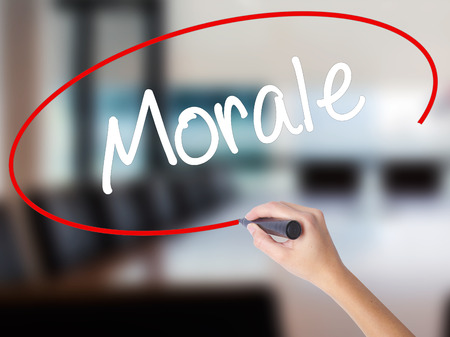 ethos: Woman Hand Writing Morale with a marker over transparent board. Isolated on Office. Business concept. Stock Photo