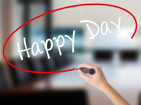 Woman Hand Writing  Happy Day with a marker over transparent board. Isolated on Office. Business concept. Stock Photo Stock Photo