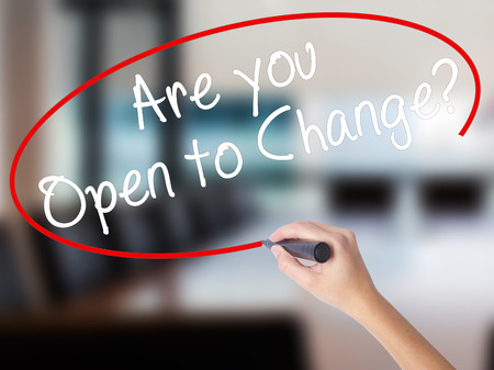 Woman Hand Writing Are you Open to Change? with a marker over transparent board. Isolated on Office. Business concept. Stock Photo