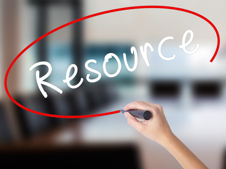 resourcefulness: Woman Hand Writing Resource with a marker over transparent board. Isolated on Office. Business concept. Stock Image