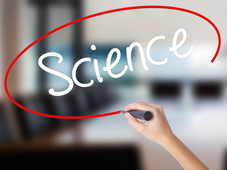 Woman Hand Writing Science with a marker over transparent board. Isolated on Office. Business concept. Stock Photo