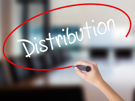 Woman Hand Writing Distribution with a marker over transparent board. Isolated on Office. Business concept. Stock Photo