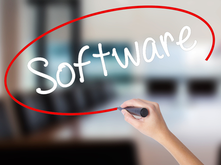 mysql: Woman Hand Writing Software  with a marker over transparent board. Isolated on Office. Business concept. Stock Photo Stock Photo