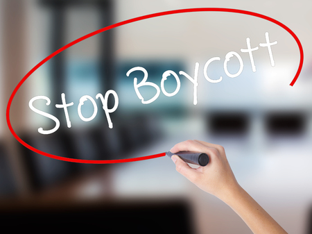 denying: Woman Hand Writing  Stop Boycott with a marker over transparent board. Isolated on Office. Business concept. Stock Photo