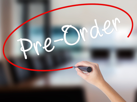 preorder: Woman Hand Writing Pre-Order  with a marker over transparent board. Isolated on Office. Business concept. Stock Photo