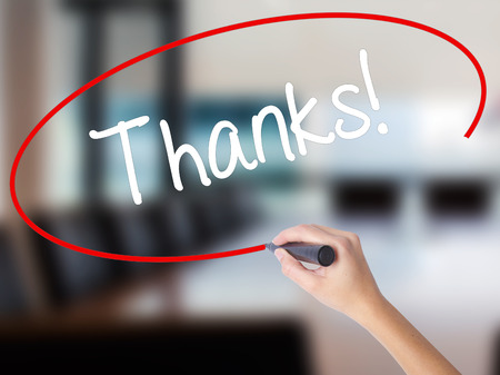 Woman Hand Writing Thanks! with a marker over transparent board. Isolated on Office. Business concept. Stock Photo Stock Photo