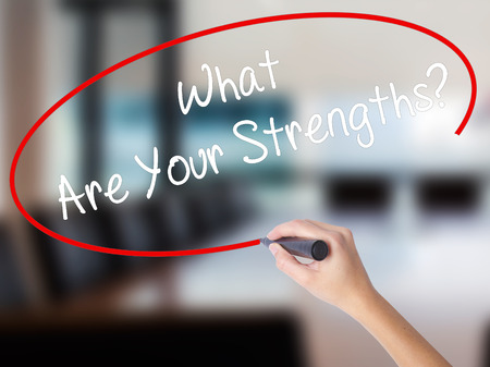 Woman Hand Writing What Are Your Strengths? with a marker over transparent board. Isolated on Office. Business concept. Stock Photo Stock Photo