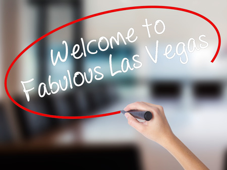 strip club: Woman Hand Writing Welcome to Fabulous Las Vegas with a marker over transparent board. Isolated on Office. Business concept. Stock Photo Stock Photo