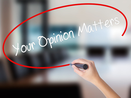 solicitation: Woman Hand Writing Your Opinion Matters with a marker over transparent board. Isolated on Office. Business concept.