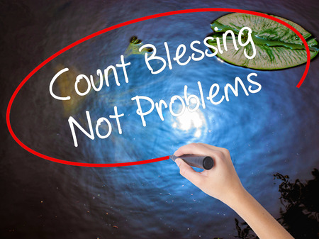 preachment: Woman Hand Writing Count Blessing Not Problems with marker over transparent board. Isolated on nature. Business concept. Stock Photo Stock Photo