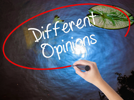 opinions: Woman Hand Writing Different Opinions with marker over transparent board. Isolated on nature. Business concept. Stock Photo
