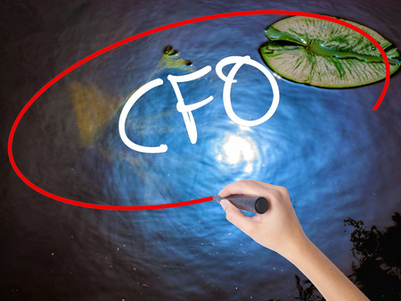 comité d entreprise: Woman Hand Writing CFO (Chief Financial Officer) with marker over transparent board. Isolated on nature. Business concept. Stock Photo