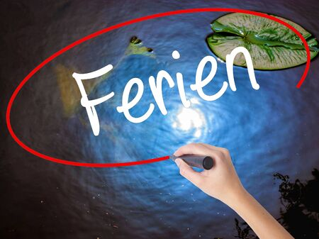 rescheduling: Woman Hand Writing Ferien  (Vacation in German) with marker over transparent board. Isolated on nature. Business concept. Stock Photo Stock Photo