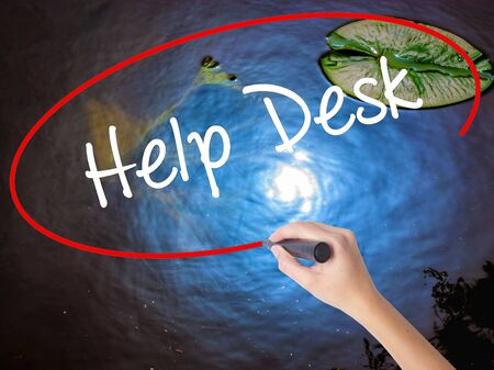 virtual assistant: Woman Hand Writing Help Desk with marker over transparent board. Isolated on nature. Business concept. Stock Photo Stock Photo