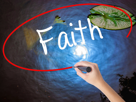love proof: Woman Hand Writing Faith with marker over transparent board. Isolated on nature. Business concept. Stock Photo Stock Photo