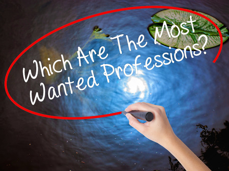 most talent: Woman Hand Writing Which Are The Most Wanted Professions? with marker over transparent board. Isolated on nature. Business concept. Stock Photo Stock Photo