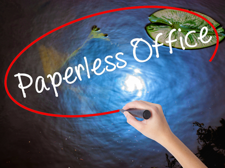 paperless: Woman Hand Writing Paperless Office  with marker over transparent board. Isolated on nature. Business concept. Stock Photo Stock Photo