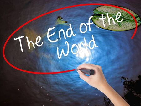 near death: Woman Hand Writing The End of the World with marker over transparent board. Isolated on nature. Business concept. Stock Photo Stock Photo