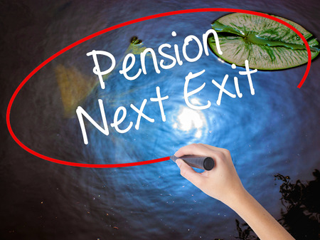 Woman Hand Writing Pension Next Exit with marker over transparent board. Isolated on nature. Business concept. Stock Photo