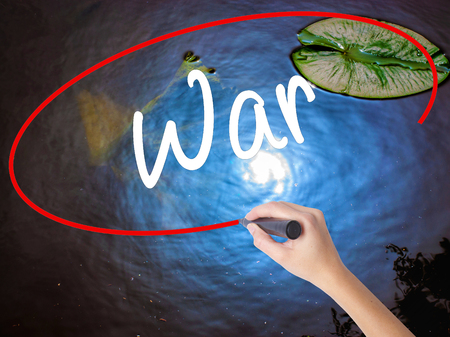 feeling happy: Woman Hand Writing War with marker over transparent board. Isolated on nature. Business concept. Stock Photo